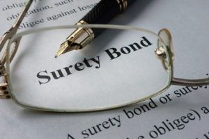 Page of newspaper with words surety bond.